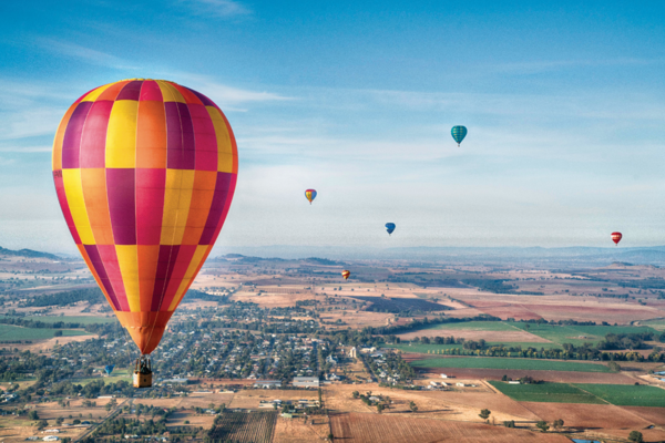 Hot air balloons flying over central NSW during the Canowindra International Balloon Challenge (Destination NSW)