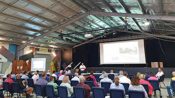 Images shows people attending the public information session in Morundah, NSW.